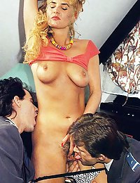 Hairy seventies lady enjoys two big cocks at the same time