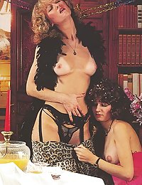 Two seventies ladies with stockings sharing a stiff cock