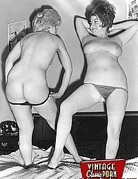 Two very sexy and vintage girls posing in the nude together